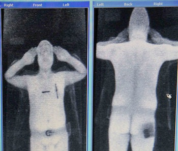 A computer screen shows a scan of a security official in a RapiScan full-body scanner being trialled at Manchester Airport in Manchester, northern England